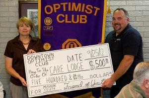 Care Lodge Director Leslie Payne is presented with a donation by DTOC President Eddy Chaney