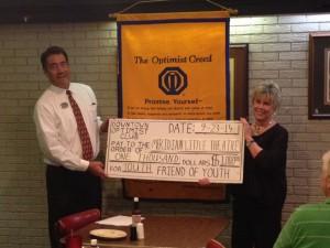 Former President Dan Derrington Presents MLT Donation To Sidney Covington