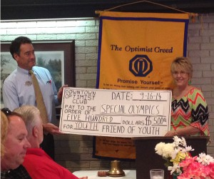 Former President Dan Derrington Presents The DTOC Special Olympics Donation to Kristie Anders