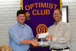 DTOC President Daniel Stewart Presents A Check to Deb Dad Scott Gray