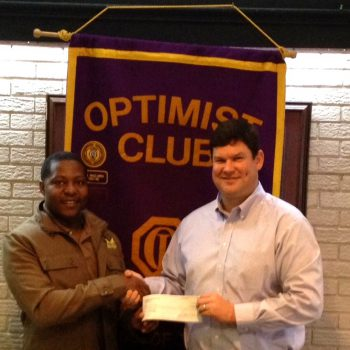 DTOC President Daniel Stewart Presents A Check To James Carter, Founder Of The Carter Foundation