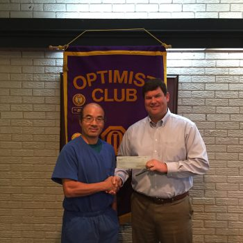 DTOC President Daniel Stewart Presents A Check To Camp Eagle Ridge Founder Dan Fritts