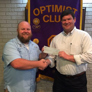 DTOC President Daniel Stewart (r) Presents FCA Director Brandon Dewease (l) With A Donation