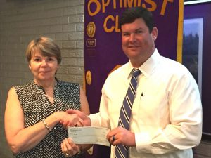 Director Leslie Payne receives a donation from DTOC President Daniel Stewart