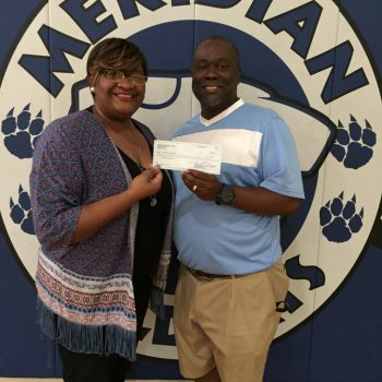 DTOC Member Brittany Kennedy Presents A Check To Coach Ron Norman