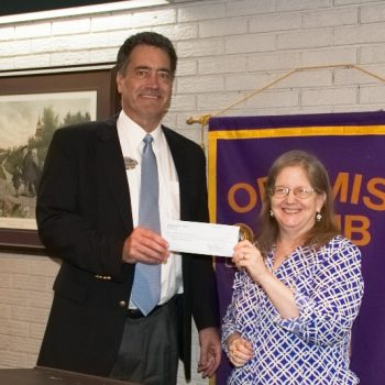 DTOC President Dan Derrington Presents A Check To MLT Director Ellie Massey