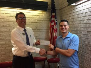 DTOC President Dan Derrington Presents FCA Area Director Jonathan Fulcher With Donation